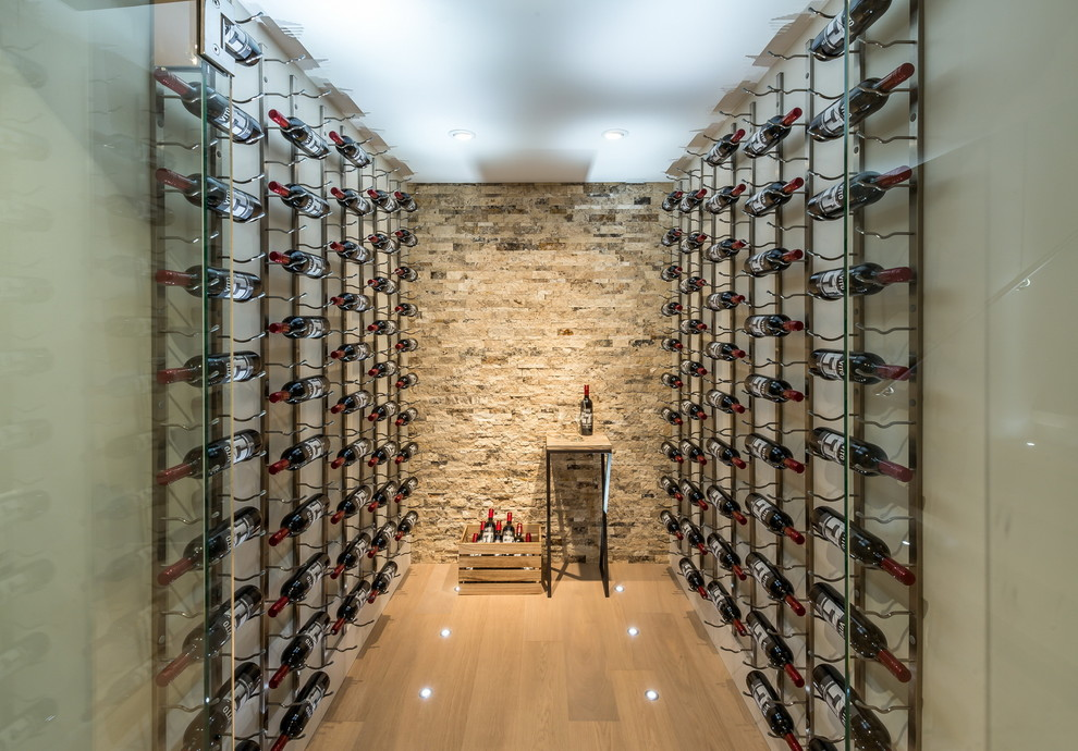 Inspiration for a contemporary wine cellar remodel in Vancouver