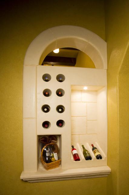 Wine Rooms by Stadler Custom Homes mediterranean