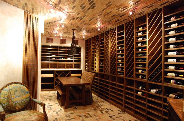 Wine rooms by stadler custom homes mediterranean wine for Wine rooms in homes