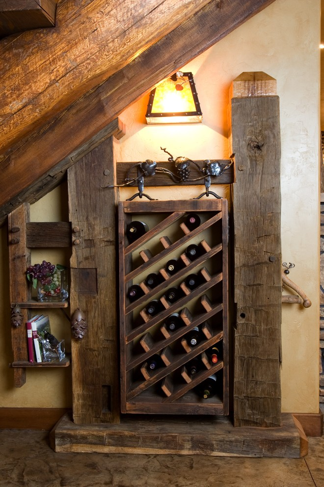 Example of a mountain style wine cellar design in Denver