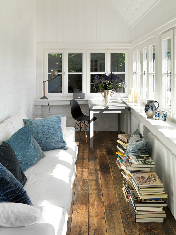 Small country dark wood floor and brown floor sunroom photo in Berlin with no fireplace and a standard ceiling