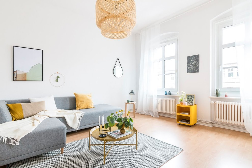 Living room - mid-sized scandinavian laminate floor and beige floor living room idea in Other with white walls, no tv and no fireplace