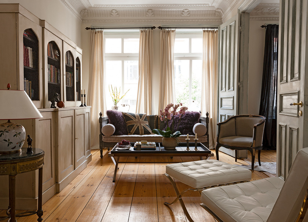 Inspiration for a mid-sized timeless formal and enclosed medium tone wood floor living room remodel in Hamburg with beige walls and no fireplace