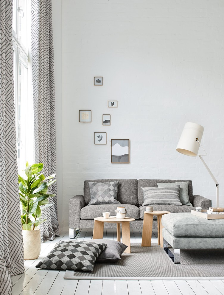 Inspiration for a small scandinavian enclosed painted wood floor and white floor family room remodel in Other with white walls, no fireplace and no tv