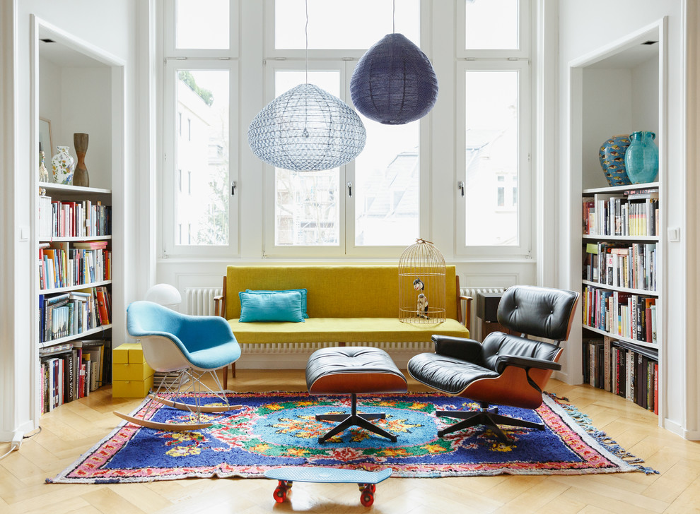 Family room library - mid-sized eclectic enclosed light wood floor and beige floor family room library idea in Berlin with white walls