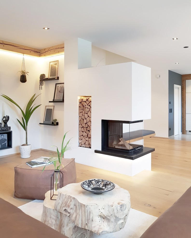 Living room - scandinavian formal and open concept light wood floor and beige floor living room idea in Other with white walls and a two-sided fireplace