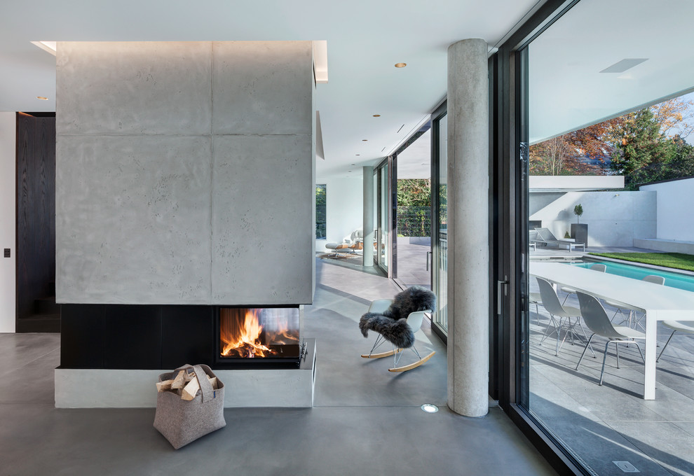 Inspiration for a huge modern formal and loft-style linoleum floor and gray floor living room remodel in Munich with white walls, a two-sided fireplace, a concrete fireplace and no tv