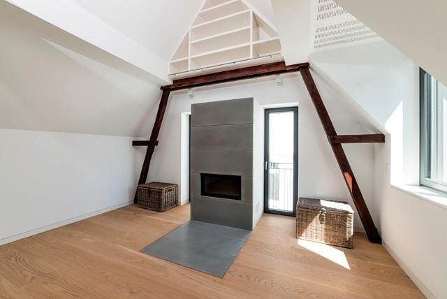 Dachgeschossausbau Hamburg kamin aus sichtbeton im loftartigen dachgeschoß modern