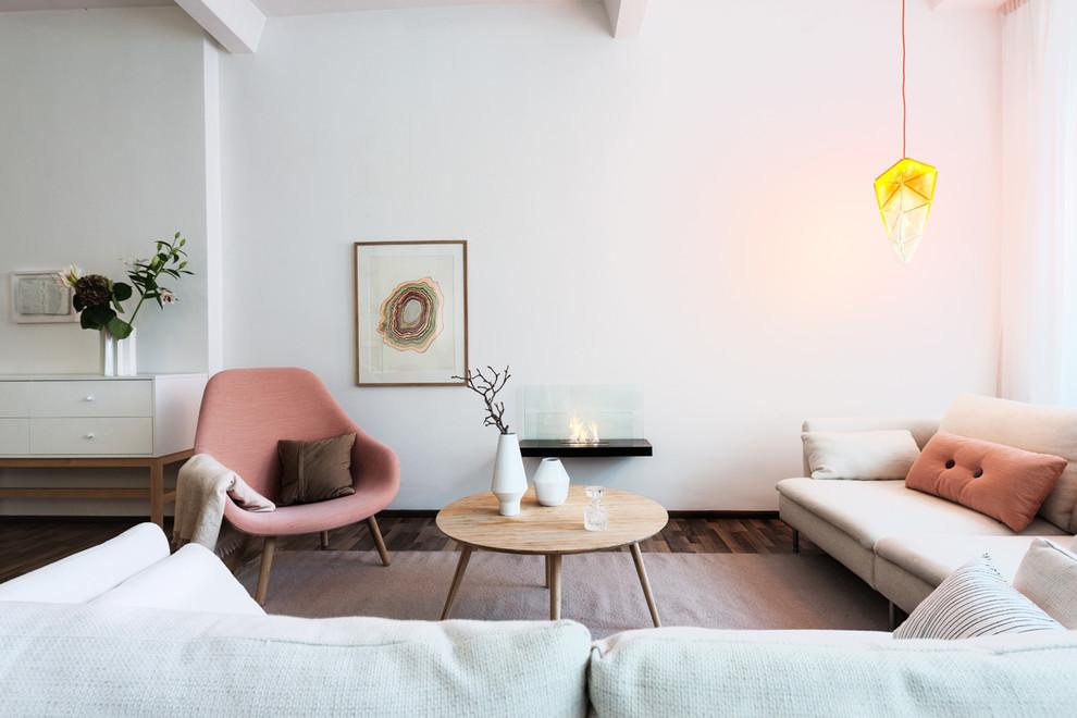 Living room - mid-sized scandinavian formal dark wood floor living room idea in Berlin with white walls and no tv