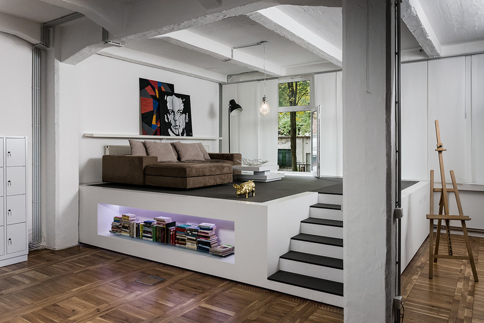 Inspiration for a small industrial mezzanine living room in Other with white walls, medium hardwood flooring, no fireplace and no tv.