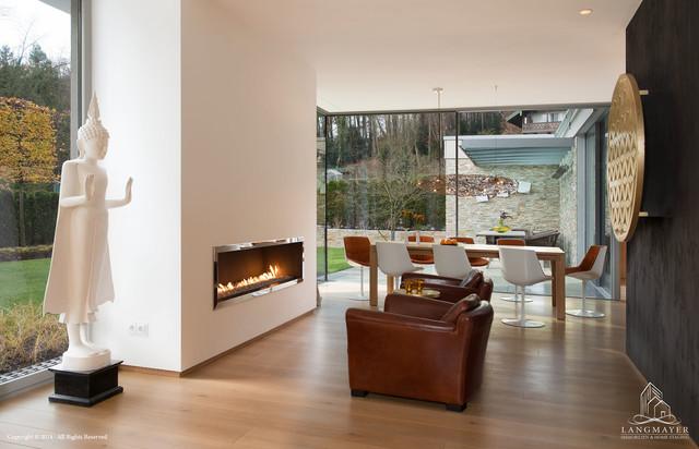 Modernes einfamilienhaus im bauhausstil mit hochwertiger ausstattung bauhaus look wohnzimmer - Modernes wohnen wohnzimmer ...