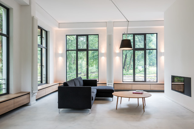 Example of a trendy open concept carpeted family room design in Berlin with white walls