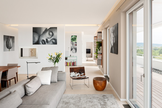 Inspiration for a contemporary open concept light wood floor family room remodel in Berlin with beige walls