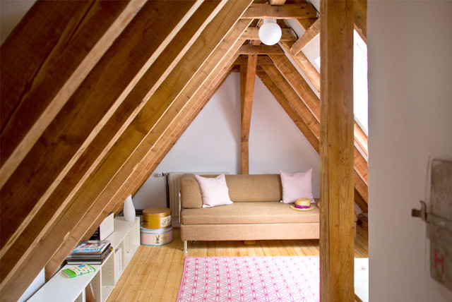Example of a danish enclosed light wood floor living room design in Other with white walls