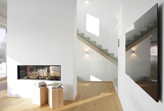 Fußner Kühne split level wohnen an der lechleite minimalistisch wohnbereich