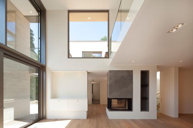 Wohnzimmer und Kamin moderne wohnzimmer mit galerie : Wohnraum - Modern - Wohnzimmer - Essen - von ARCHITEKTEN BRÜNING REIN