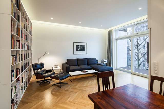 Mid-sized trendy open concept medium tone wood floor family room photo in Dusseldorf with white walls and no fireplace