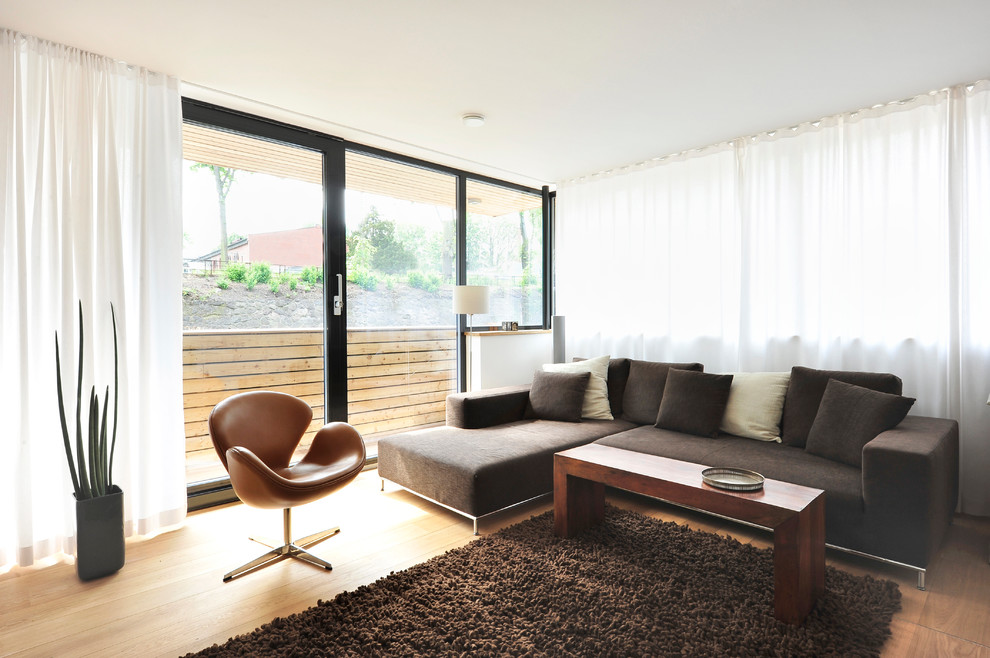 Inspiration for a modern formal light wood floor living room remodel in Hamburg with no fireplace and no tv