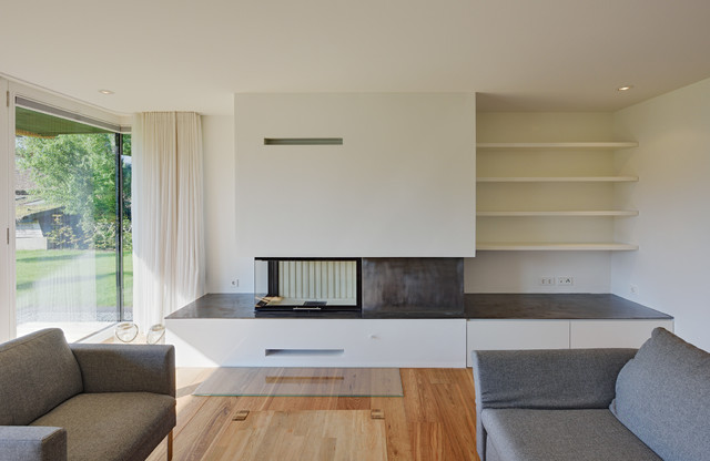 Example Of A Trendy Family Room Design In Berlin