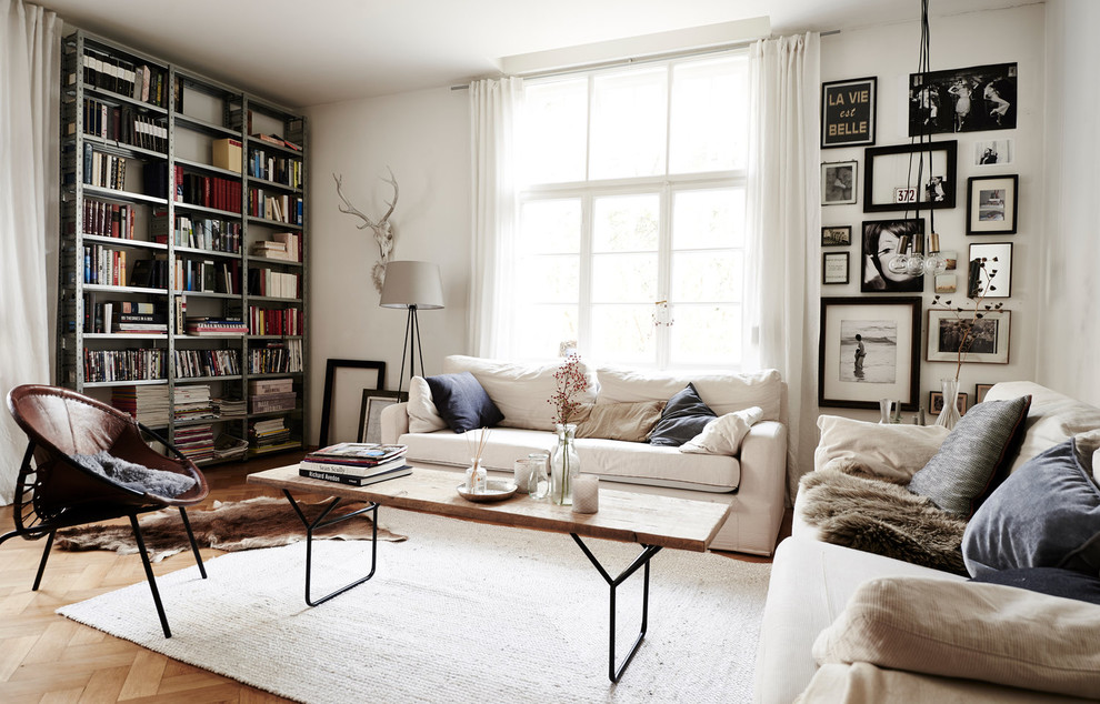 Small danish formal and enclosed light wood floor and beige floor living room photo in Munich with white walls and no fireplace