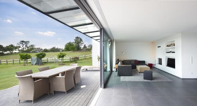 Zuckerw rfel auf dem h gel modern family room other for Architekten wohnzimmer